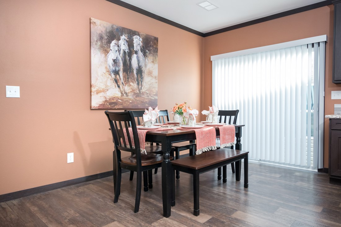 The THE DAYTONA 28 Dining Area. This Manufactured Mobile Home features 4 bedrooms and 2 baths.