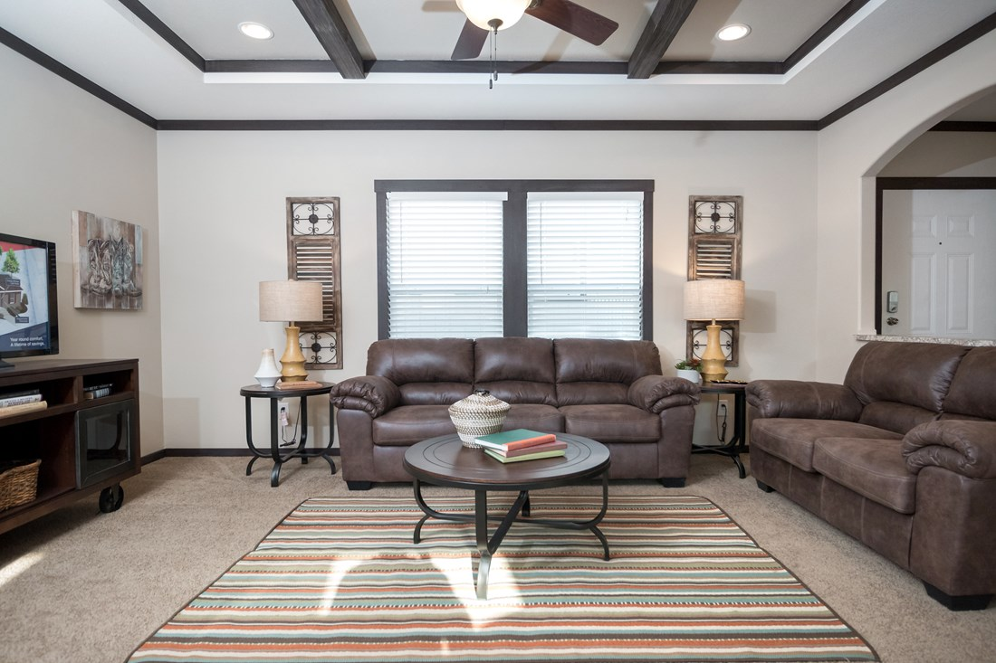 The THE DAYTONA 28 Living Room. This Manufactured Mobile Home features 4 bedrooms and 2 baths.