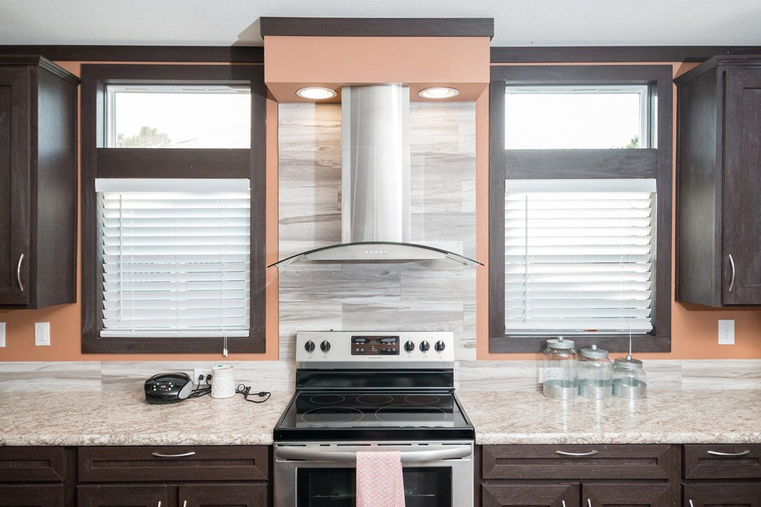 The THE DAYTONA 28 Kitchen. This Manufactured Mobile Home features 4 bedrooms and 2 baths.
