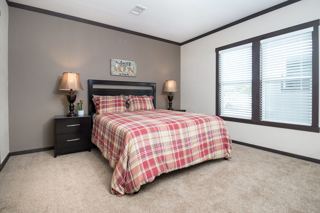 The THE DAYTONA 28 Master Bedroom. This Manufactured Mobile Home features 4 bedrooms and 2 baths.