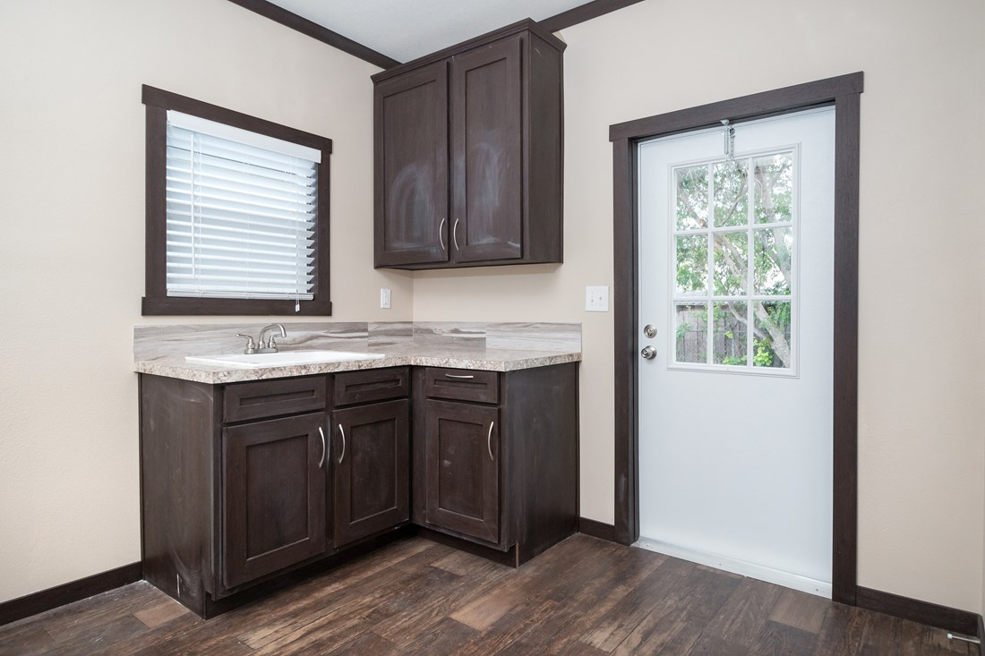 The THE DAYTONA 28 Utility Room. This Manufactured Mobile Home features 4 bedrooms and 2 baths.
