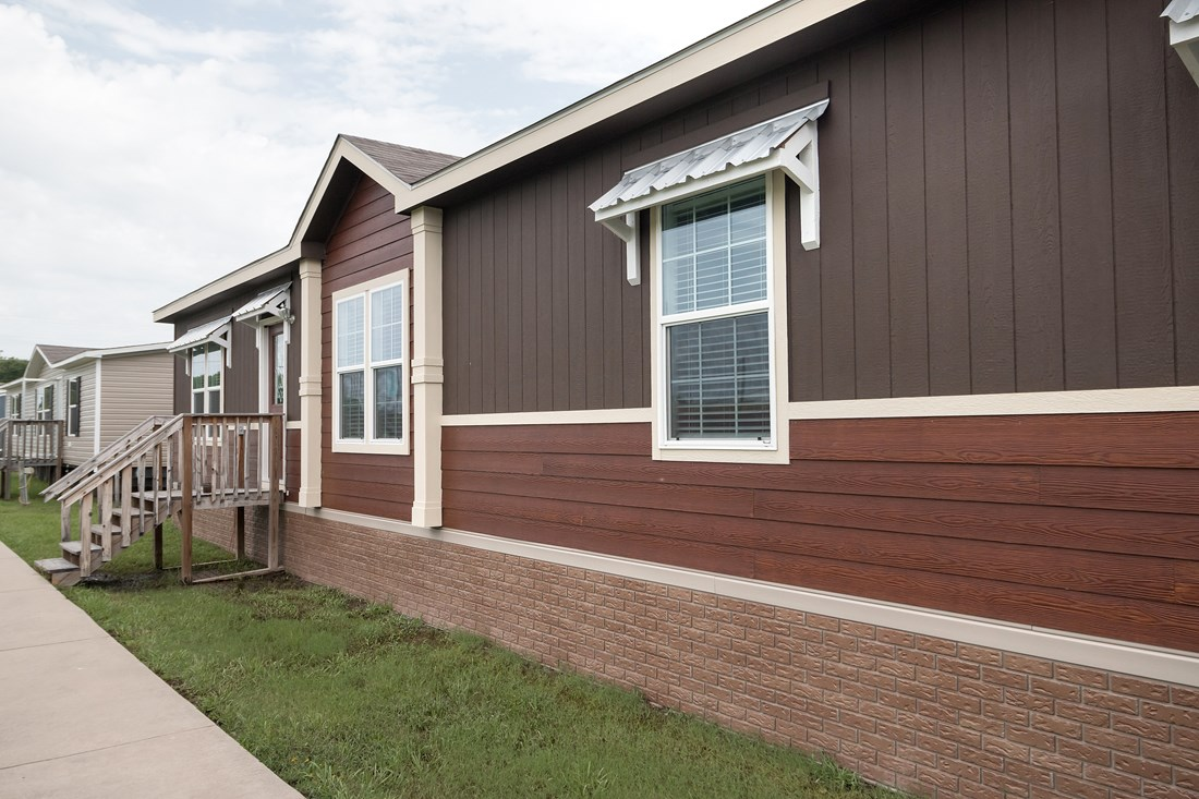 The THE PECOS 32 Exterior. This Manufactured Mobile Home features 3 bedrooms and 2 baths.