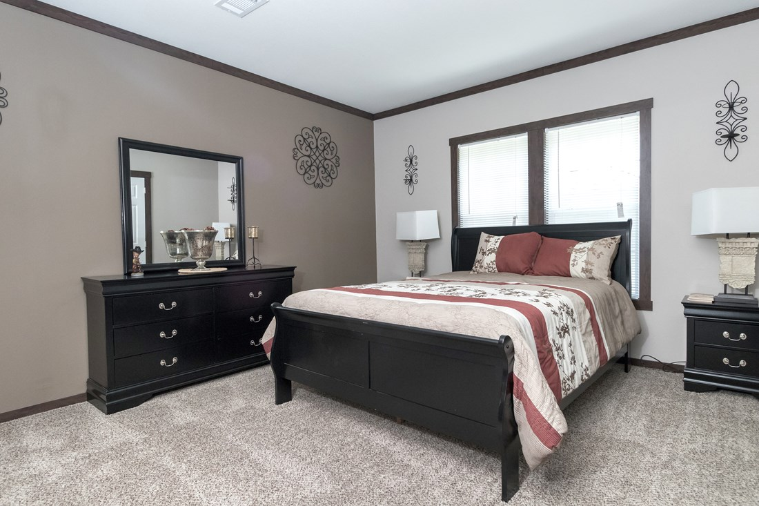 The THE SUPER HOUSTON 32 Master Bedroom. This Manufactured Mobile Home features 4 bedrooms and 2 baths.