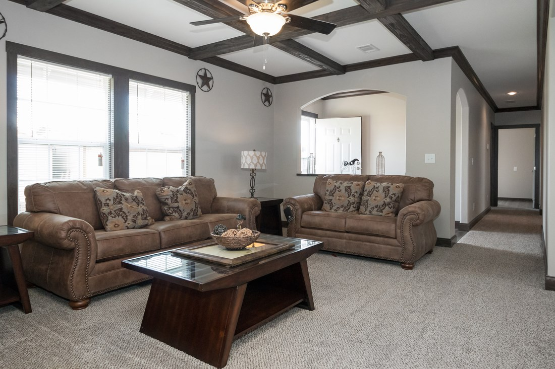 The THE SUPER HOUSTON 32 Living Room. This Manufactured Mobile Home features 4 bedrooms and 2 baths.