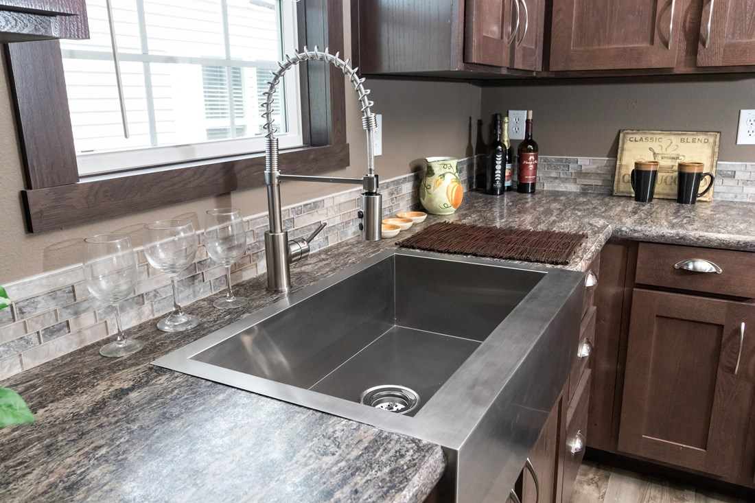 The THE SUPER HOUSTON 32 Kitchen. This Manufactured Mobile Home features 4 bedrooms and 2 baths.