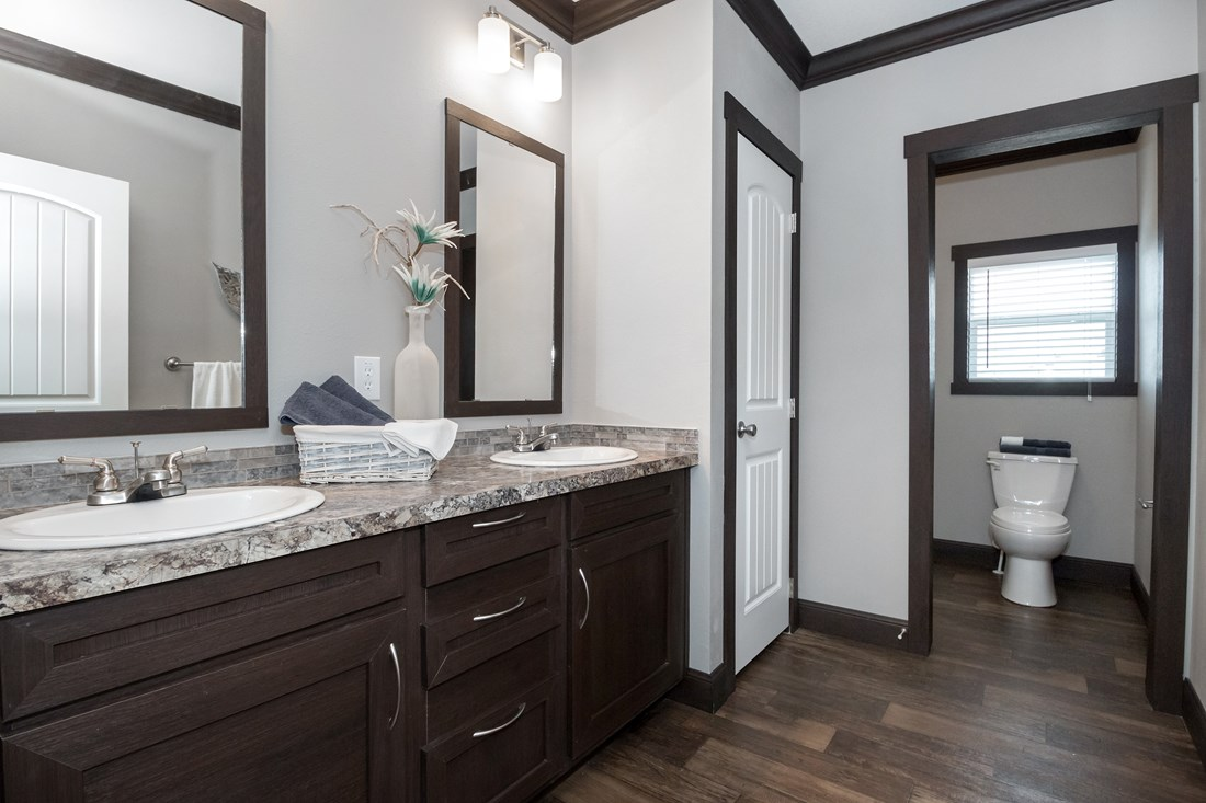 The THE NILE Guest Bathroom. This Manufactured Mobile Home features 3 bedrooms and 2 baths.