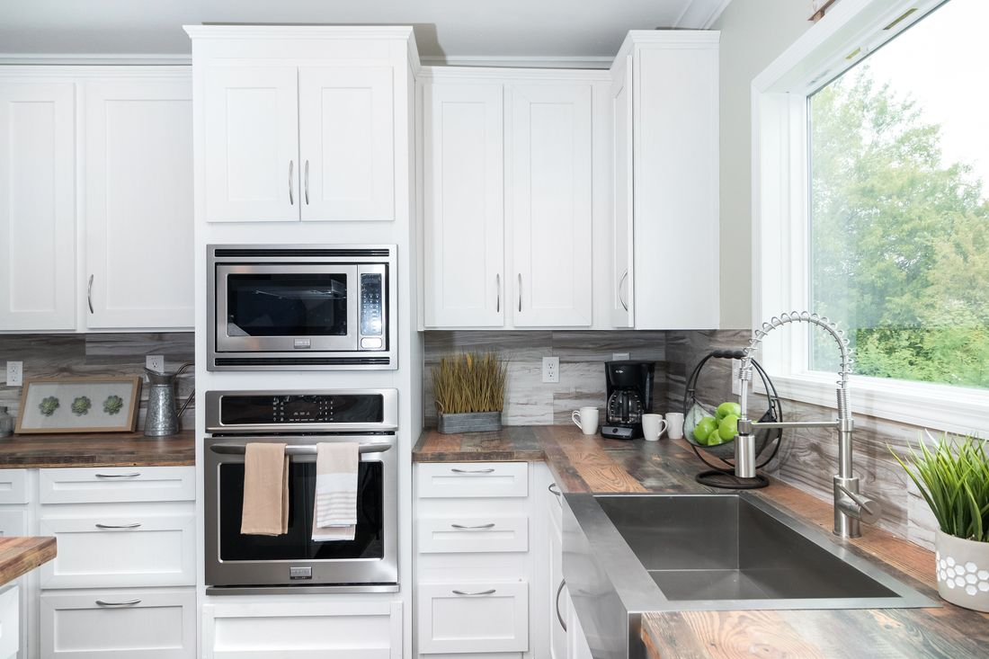 The THE JACKSON Kitchen. This Manufactured Mobile Home features 3 bedrooms and 2 baths.