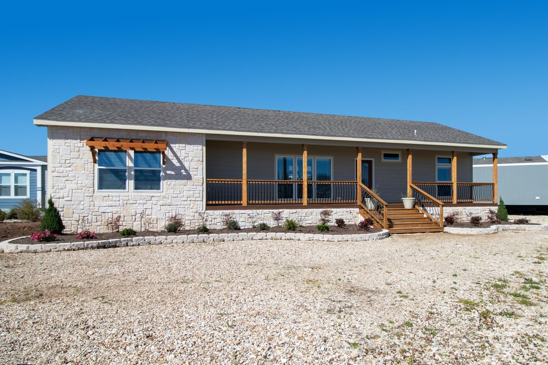 The THE CABIN Exterior. This Manufactured Mobile Home features 3 bedrooms and 2 baths.