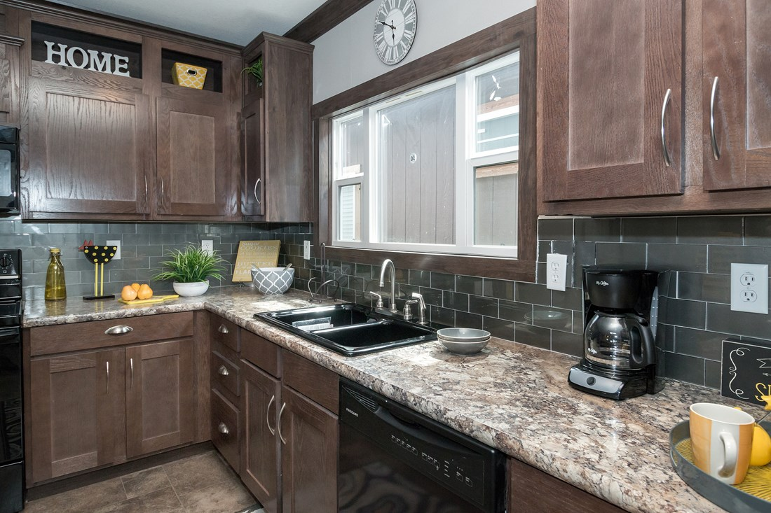The THE CLASSIC Kitchen. This Manufactured Mobile Home features 3 bedrooms and 2 baths.