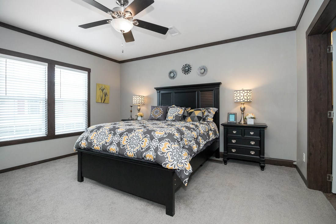 The THE CLASSIC Master Bedroom. This Manufactured Mobile Home features 3 bedrooms and 2 baths.