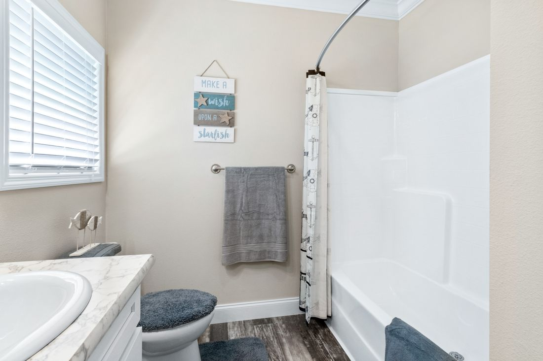 The THE CLASSIC Guest Bathroom. This Manufactured Mobile Home features 3 bedrooms and 2 baths.