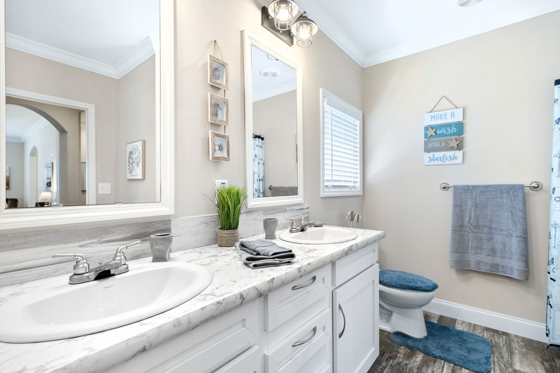 The THE CLASSIC Master Bathroom. This Manufactured Mobile Home features 3 bedrooms and 2 baths.