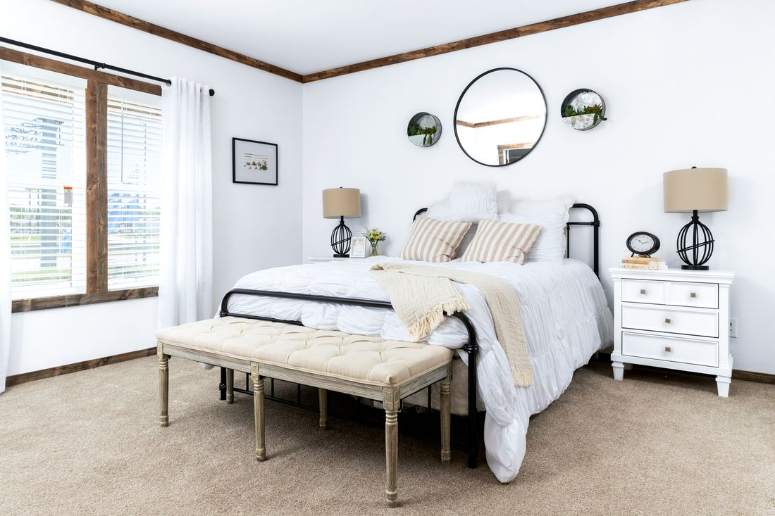 The THE DAISY-MAE Master Bedroom. This Manufactured Mobile Home features 3 bedrooms and 2 baths.