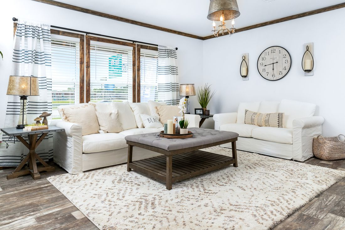 The THE DAISY-MAE Living Room. This Manufactured Mobile Home features 3 bedrooms and 2 baths.
