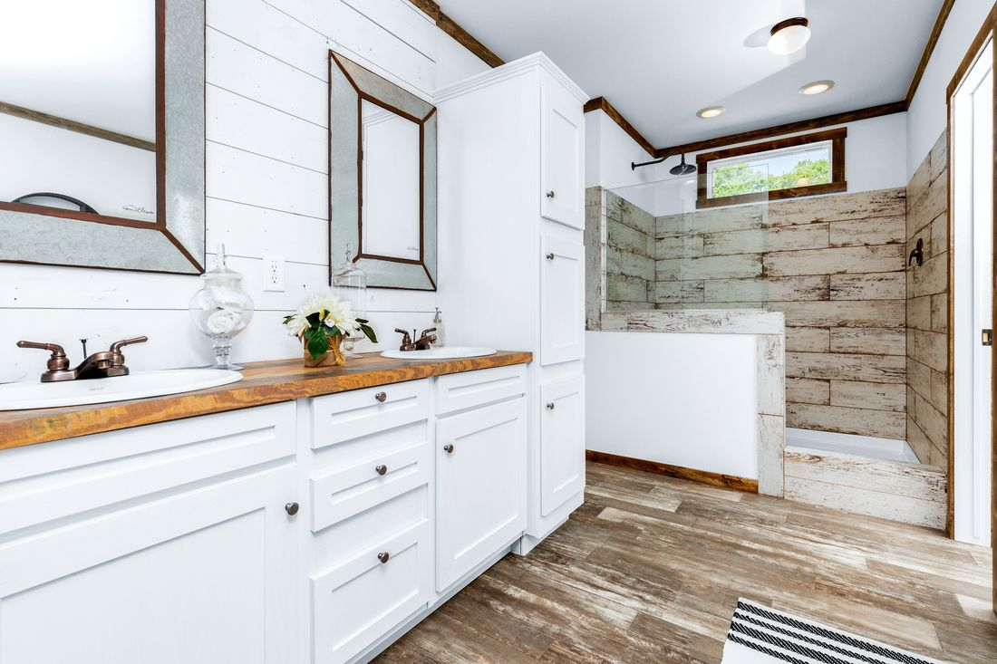 The THE DAISY-MAE Master Bathroom. This Manufactured Mobile Home features 3 bedrooms and 2 baths.