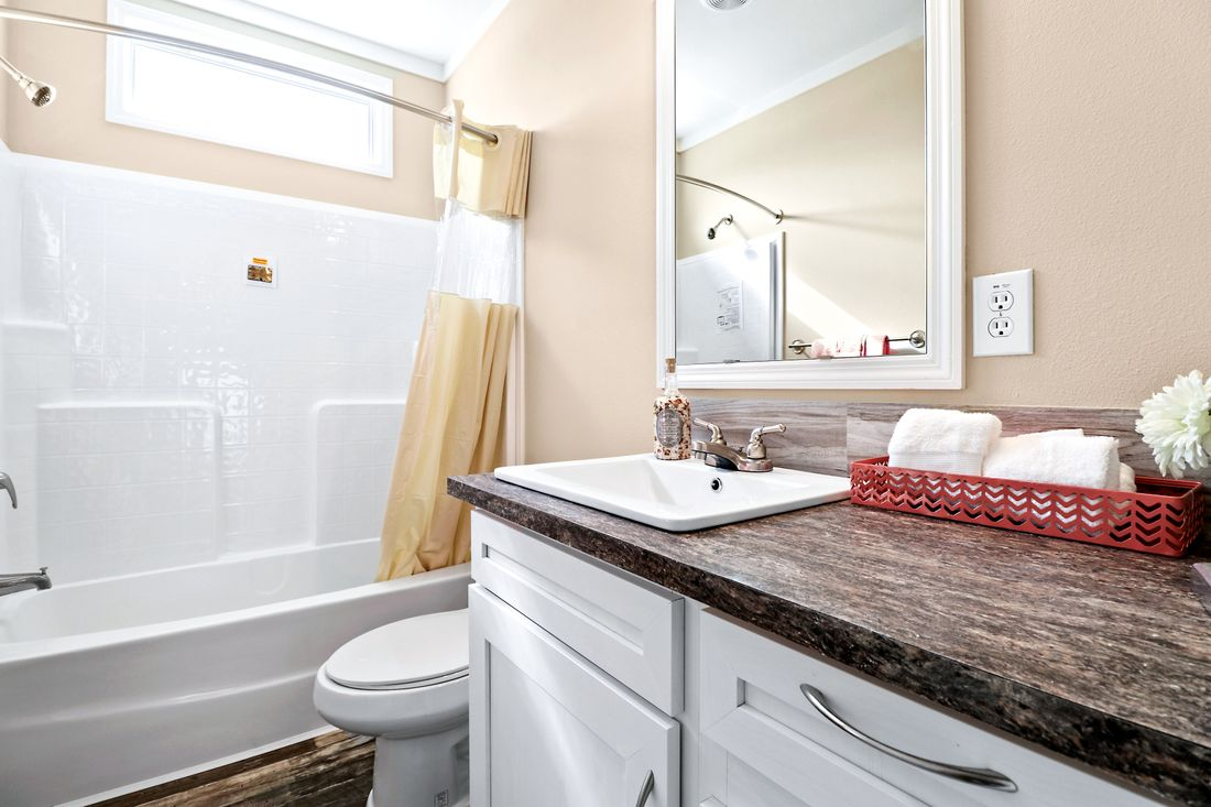 The THE CRENSHAW Guest Bathroom. This Manufactured Mobile Home features 3 bedrooms and 2 baths.