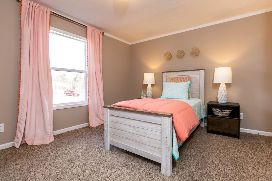 The THE ASHTON Bedroom. This Manufactured Mobile Home features 3 bedrooms and 2 baths.