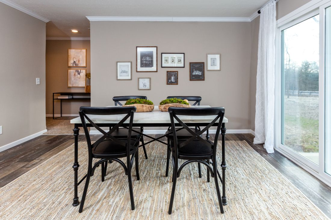 The THE ASHTON Dining Area. This Manufactured Mobile Home features 3 bedrooms and 2 baths.