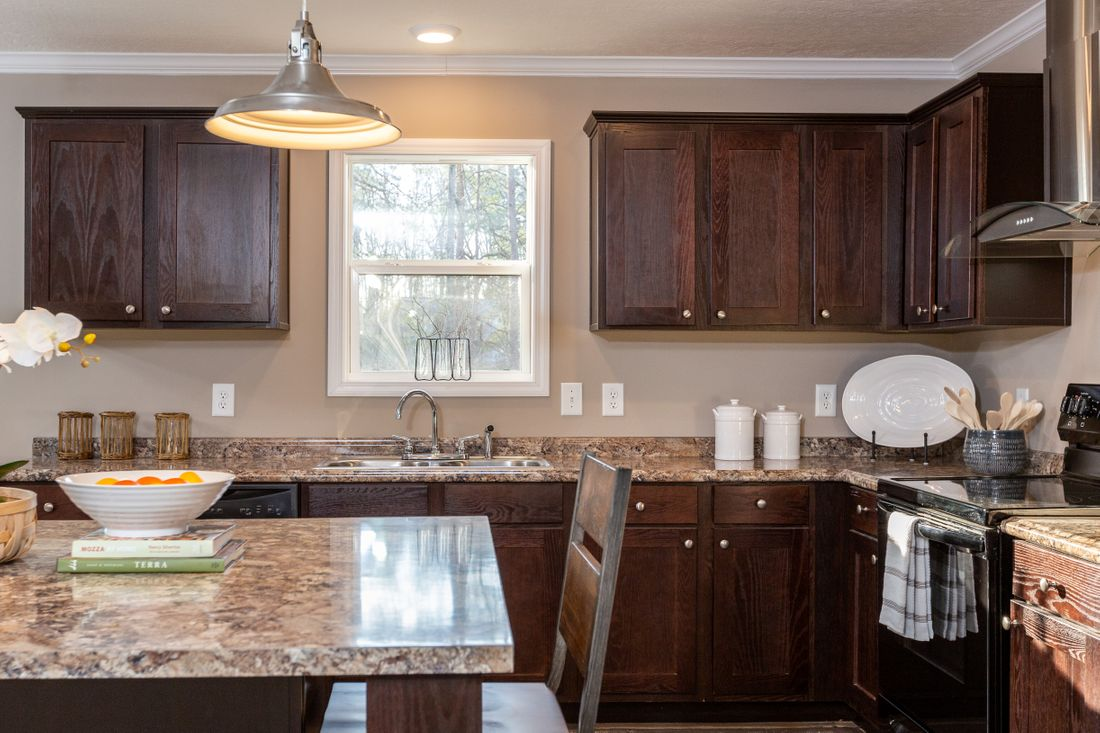 The THE ASHTON Kitchen. This Manufactured Mobile Home features 3 bedrooms and 2 baths.