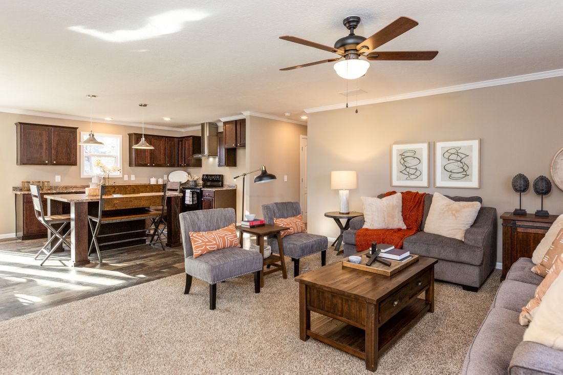 The THE ASHTON Living Room. This Manufactured Mobile Home features 3 bedrooms and 2 baths.