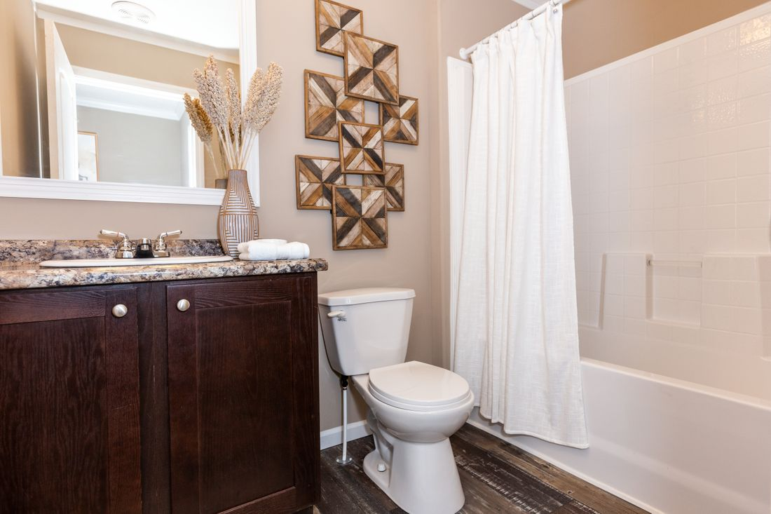 The THE ASHTON Guest Bathroom. This Manufactured Mobile Home features 3 bedrooms and 2 baths.