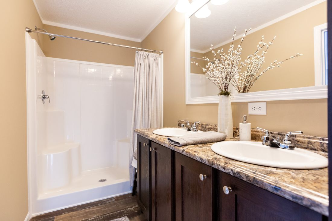 The THE ASHTON Master Bathroom. This Manufactured Mobile Home features 3 bedrooms and 2 baths.