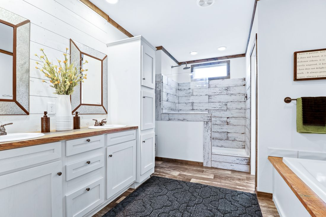 The THE DIXIE-MAE Master Bathroom. This Manufactured Mobile Home features 4 bedrooms and 3 baths.