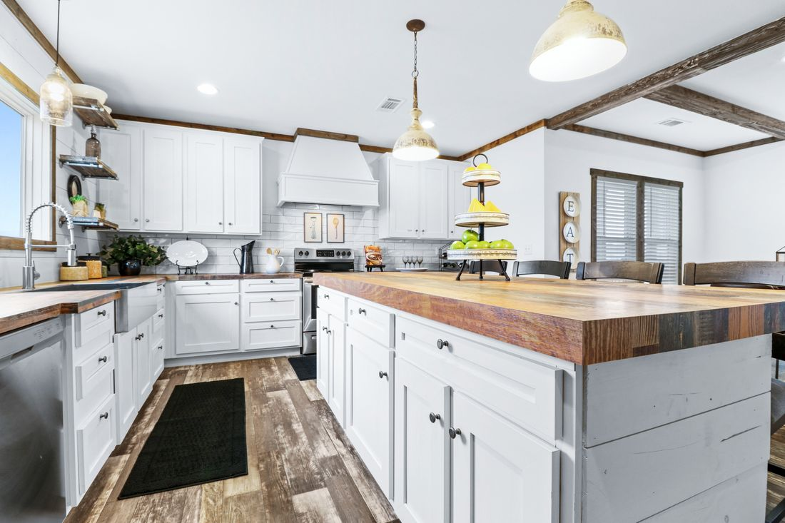 The THE DIXIE-MAE Kitchen. This Manufactured Mobile Home features 4 bedrooms and 3 baths.