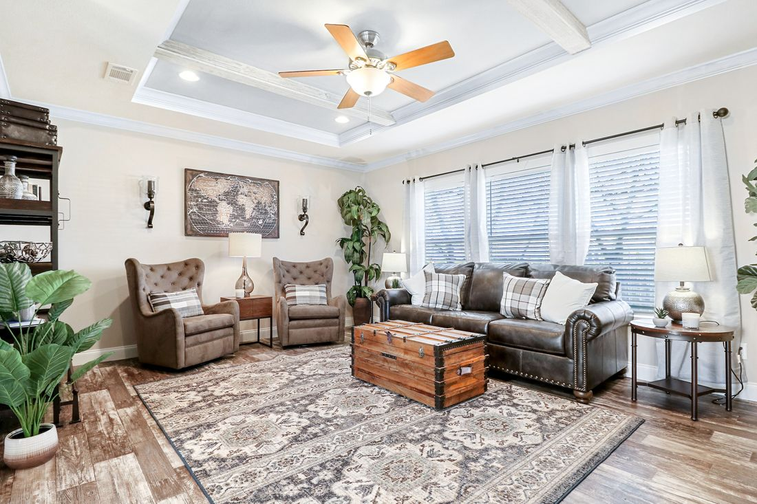 The THE TAHOE Living Room. This Manufactured Mobile Home features 3 bedrooms and 2 baths.