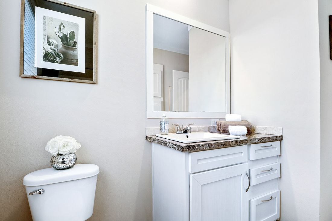 The THE TAHOE Guest Bathroom. This Manufactured Mobile Home features 3 bedrooms and 2 baths.