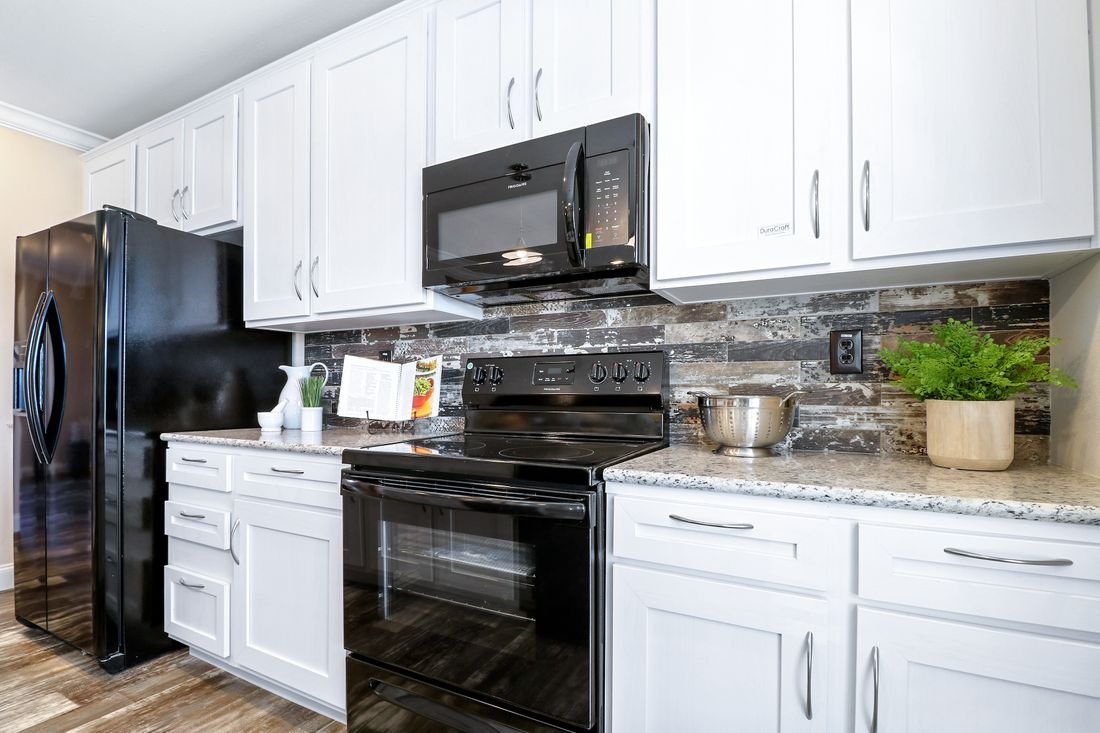 The THE TAHOE Kitchen. This Manufactured Mobile Home features 3 bedrooms and 2 baths.