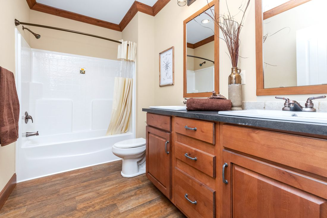 The THE BILOXI Guest Bathroom. This Manufactured Mobile Home features 3 bedrooms and 2 baths.