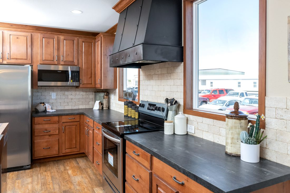 The THE BILOXI Kitchen. This Manufactured Mobile Home features 3 bedrooms and 2 baths.