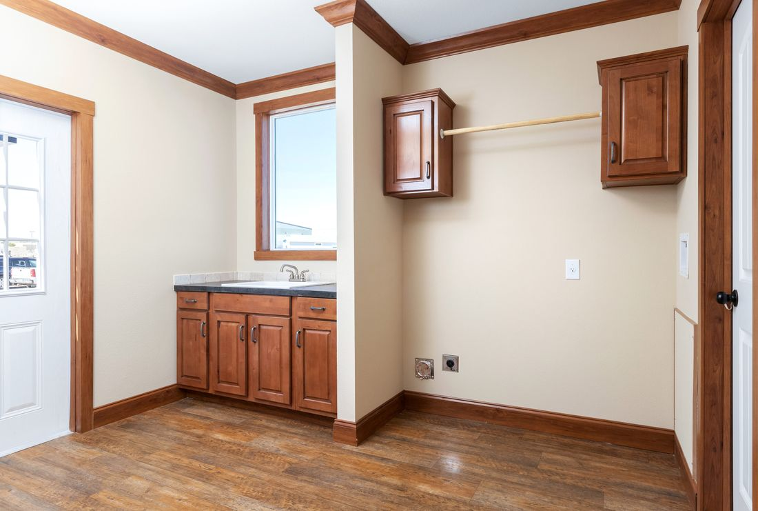 The THE BILOXI Utility Room. This Manufactured Mobile Home features 3 bedrooms and 2 baths.