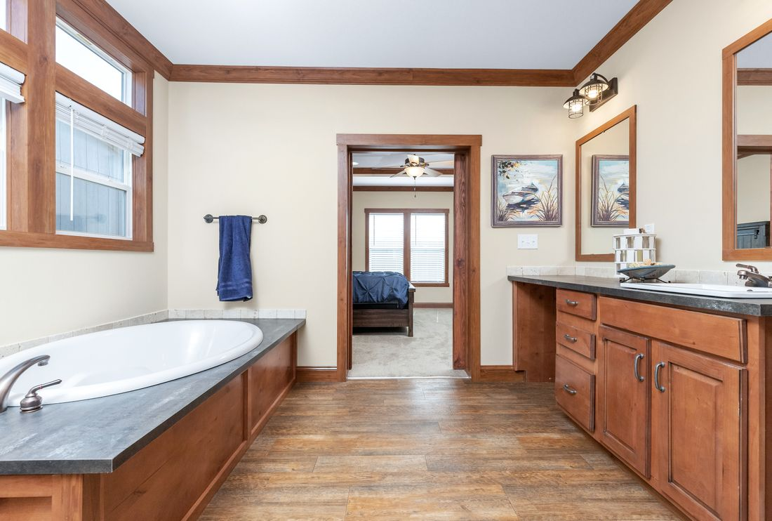 The THE BILOXI Master Bathroom. This Manufactured Mobile Home features 3 bedrooms and 2 baths.