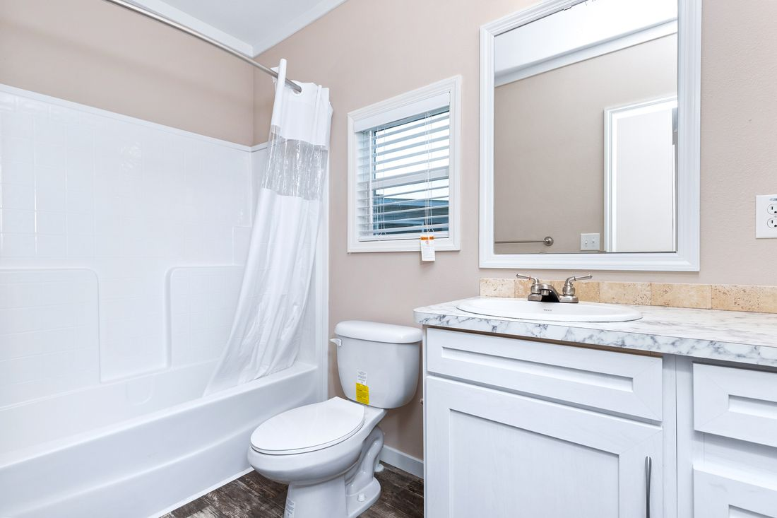 The THE HOGAN 28 Guest Bathroom. This Manufactured Mobile Home features 3 bedrooms and 2 baths.
