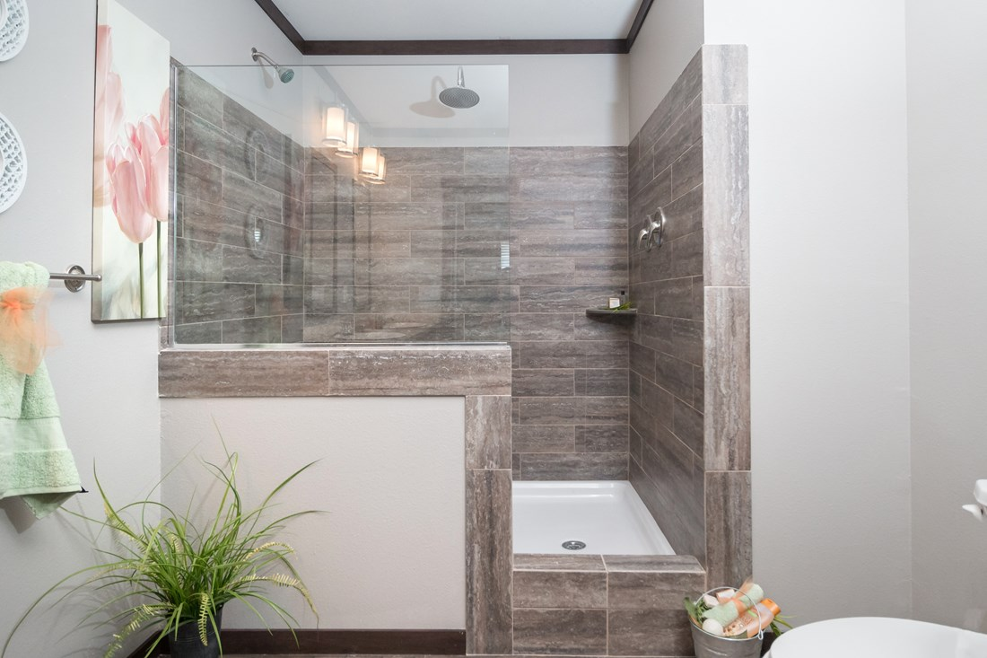 The THE HOGAN 32 Master Bathroom. This Manufactured Mobile Home features 3 bedrooms and 2 baths.