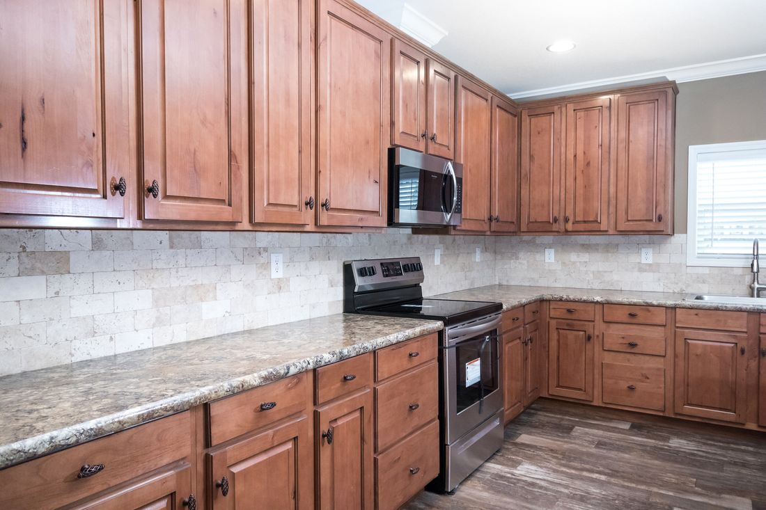 The THE SNEAD Kitchen. This Manufactured Mobile Home features 3 bedrooms and 2 baths.