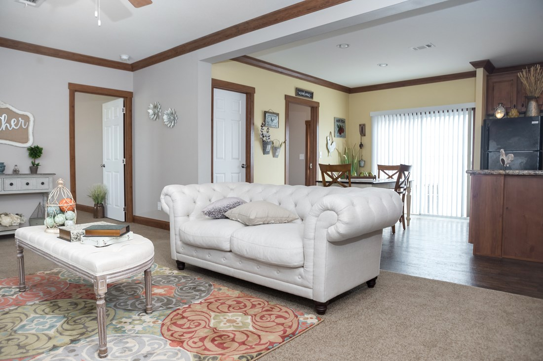 The THE FRANKLIN 28 Living Room. This Manufactured Mobile Home features 4 bedrooms and 2 baths.