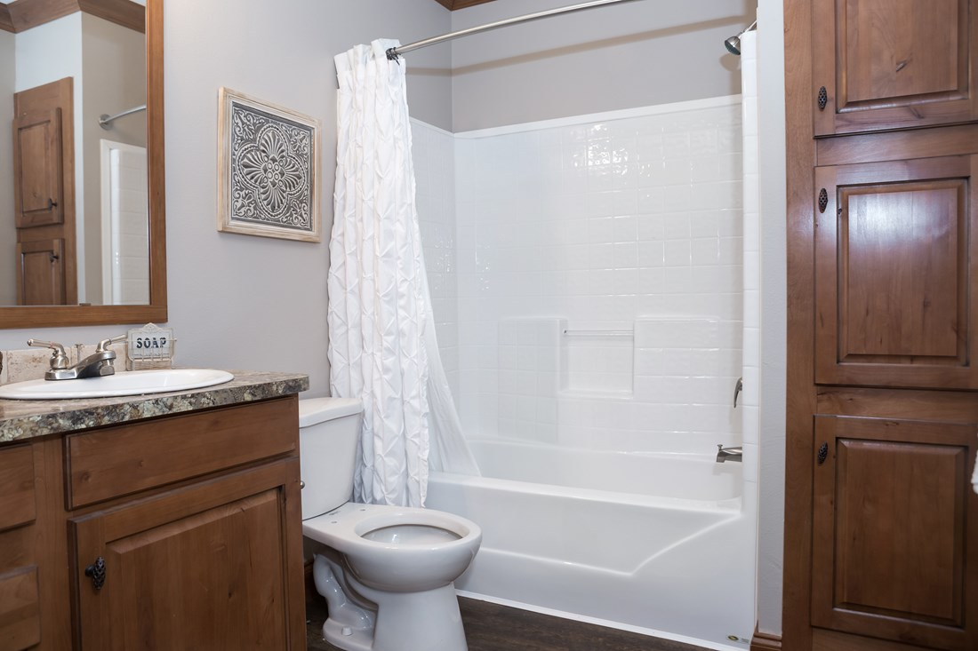 The THE FRANKLIN 28 Guest Bathroom. This Manufactured Mobile Home features 4 bedrooms and 2 baths.