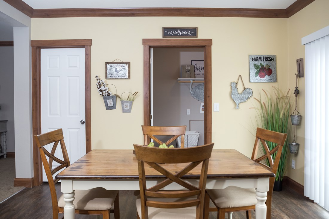 The THE FRANKLIN 28 Dining Area. This Manufactured Mobile Home features 4 bedrooms and 2 baths.