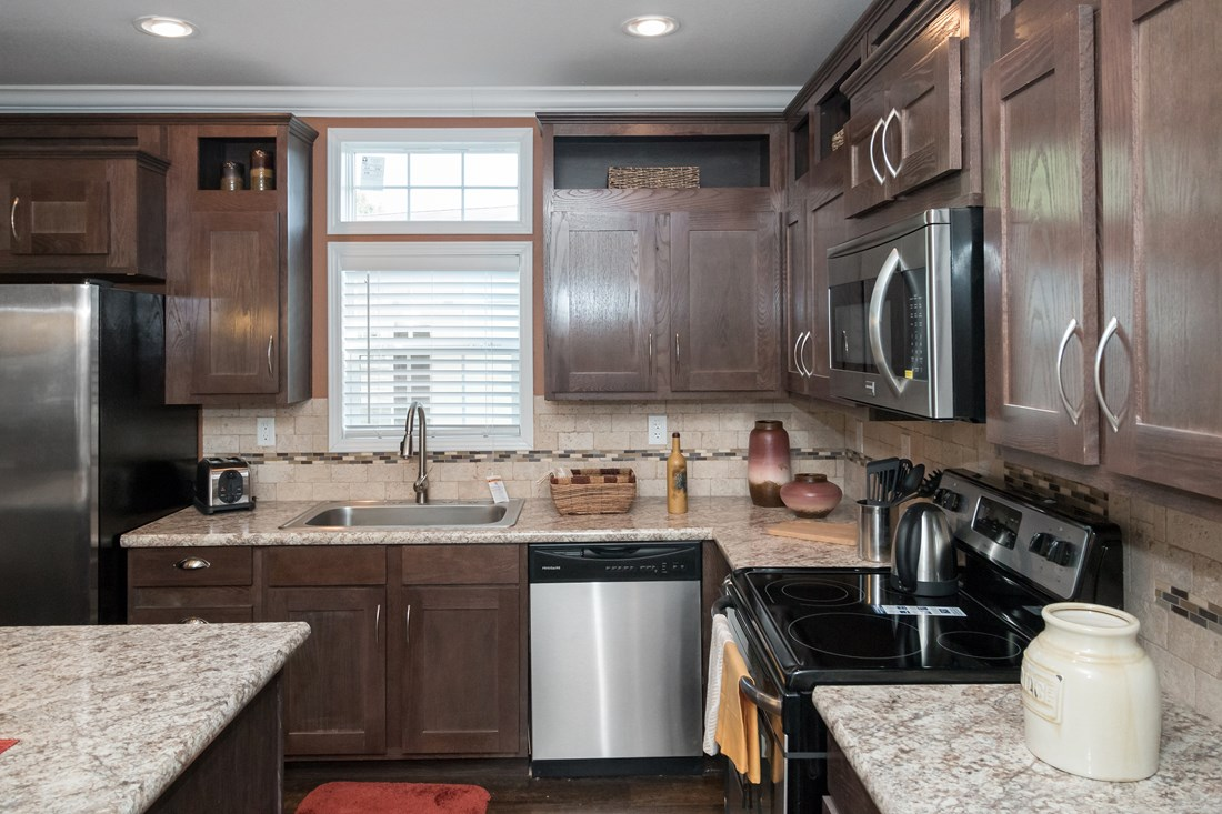 The THE FRANKLIN 32 Kitchen. This Manufactured Mobile Home features 4 bedrooms and 2 baths.