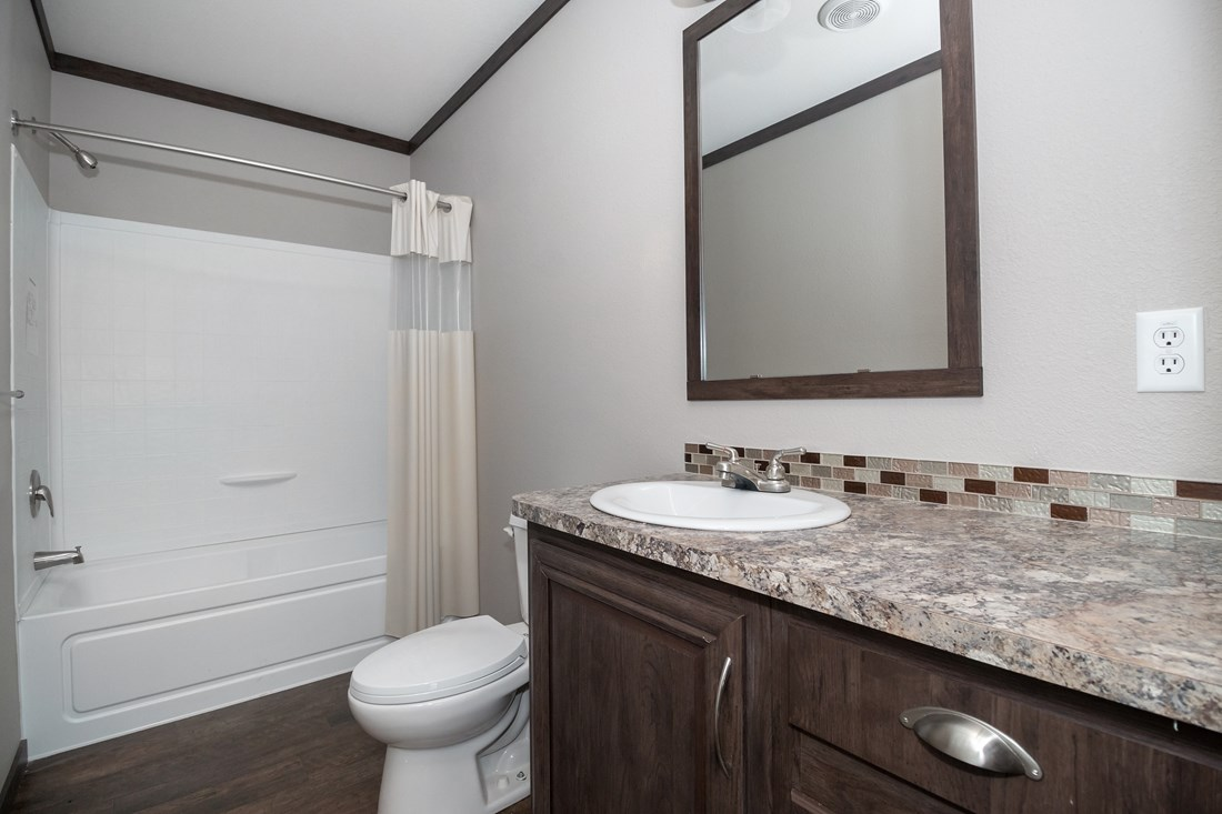 The THE STRETCH FRIO 32 Guest Bathroom. This Manufactured Mobile Home features 3 bedrooms and 2 baths.