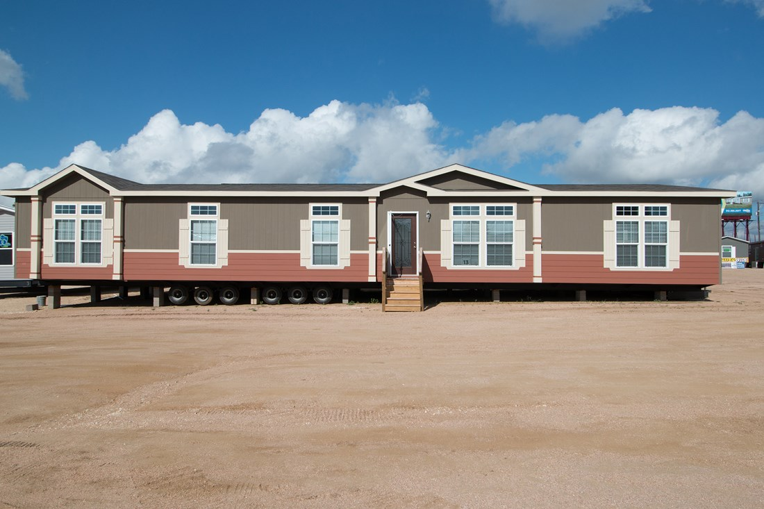 The THE OHIO Exterior. This Manufactured Mobile Home features 4 bedrooms and 2 baths.