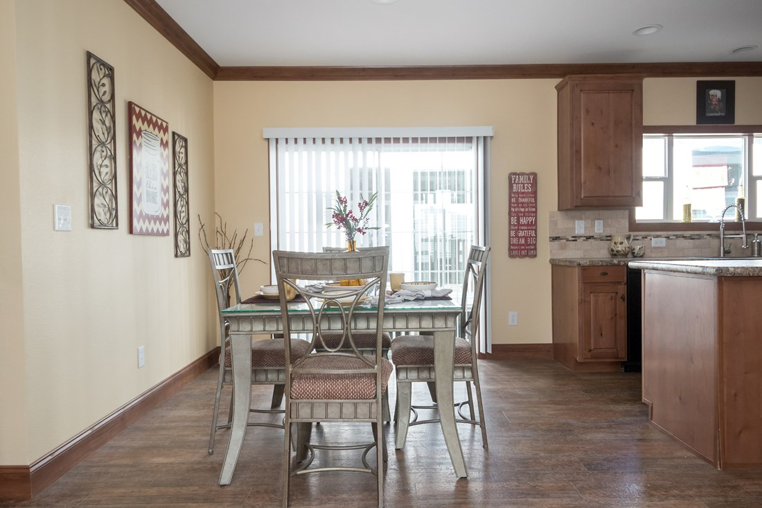The THE OHIO Dining Area. This Manufactured Mobile Home features 4 bedrooms and 2 baths.
