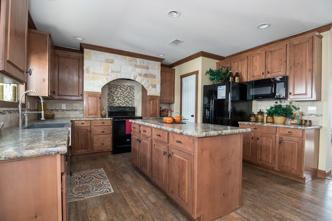 The THE OHIO Kitchen. This Manufactured Mobile Home features 4 bedrooms and 2 baths.