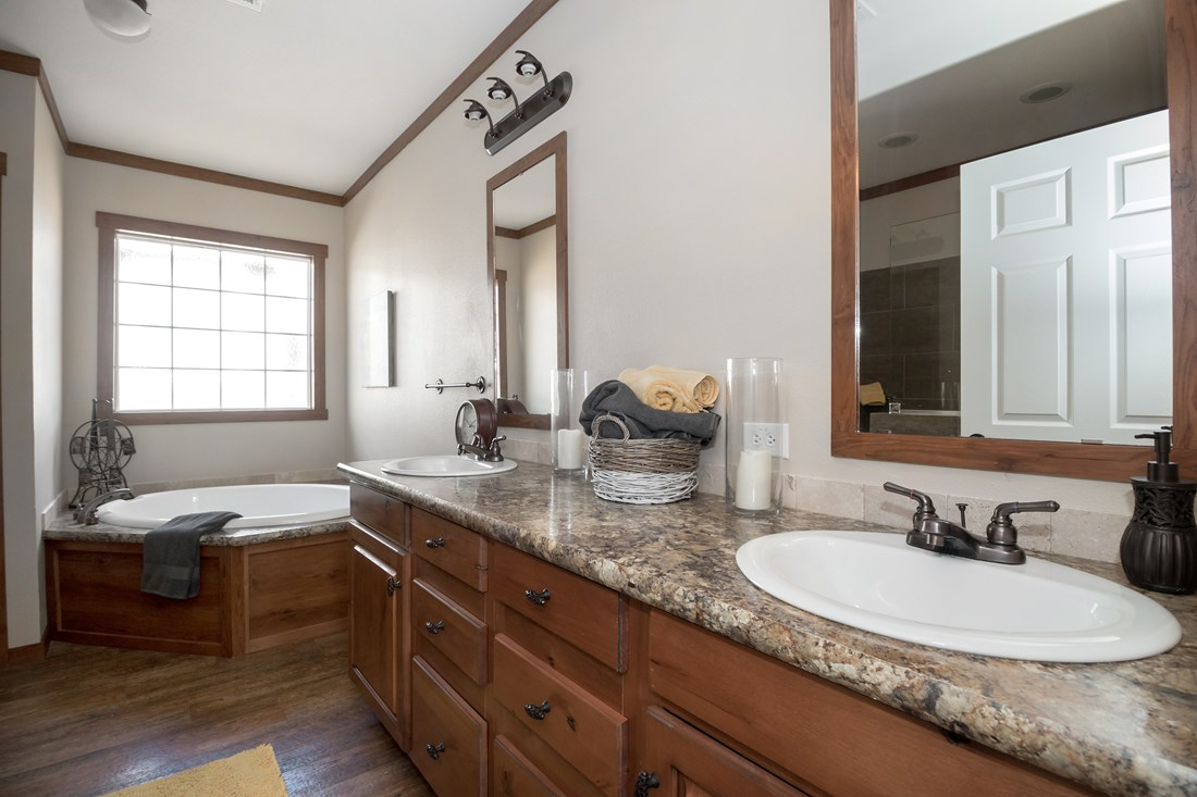 The THE OHIO Master Bathroom. This Manufactured Mobile Home features 4 bedrooms and 2 baths.