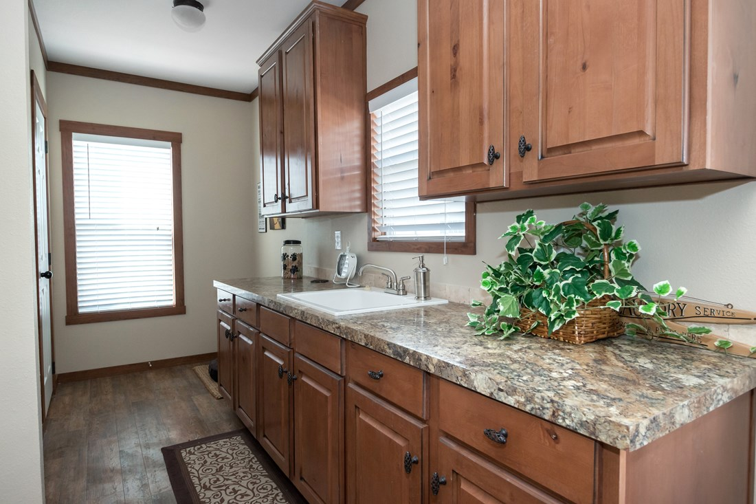 The THE OHIO Utility Room. This Manufactured Mobile Home features 4 bedrooms and 2 baths.