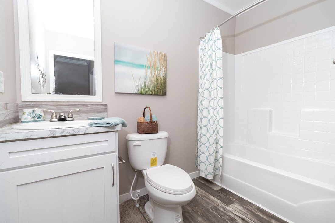 The THE STRETCH HOUSTON 32 Guest Bathroom. This Manufactured Mobile Home features 3 bedrooms and 2 baths.
