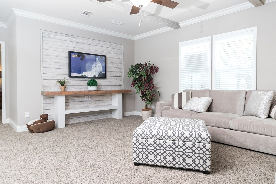 The THE STRETCH HOUSTON 32 Living Room. This Manufactured Mobile Home features 3 bedrooms and 2 baths.